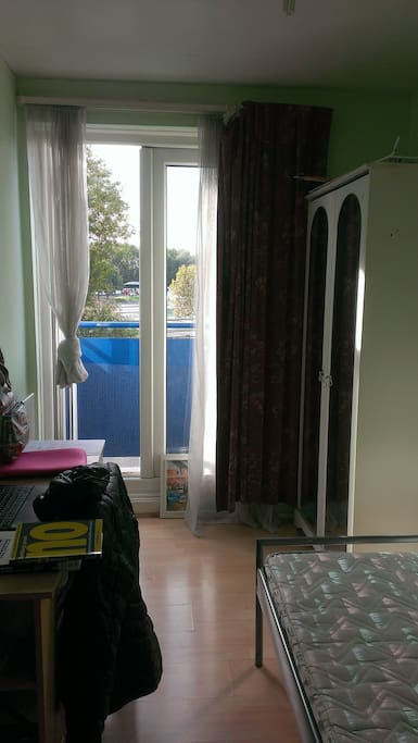 room equipped with wardrobe, desk and chair