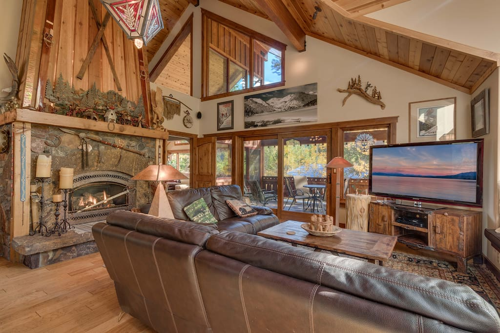 Stone fireplace and sliding glass windows to outdoor patio