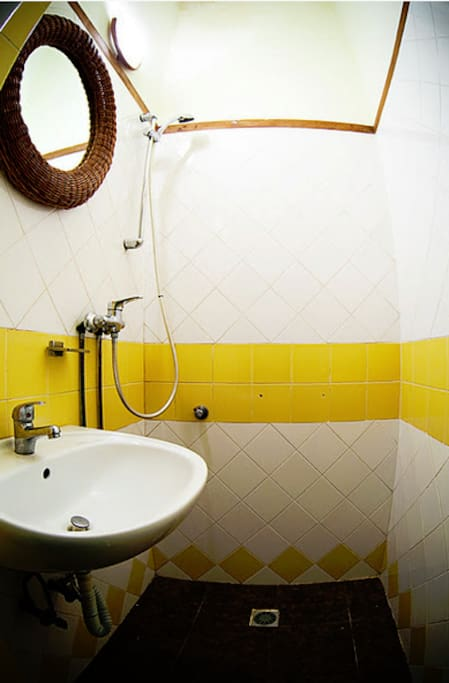 Bathroom with shower and wash-basin