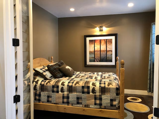 Front bedroom with a queen size bed