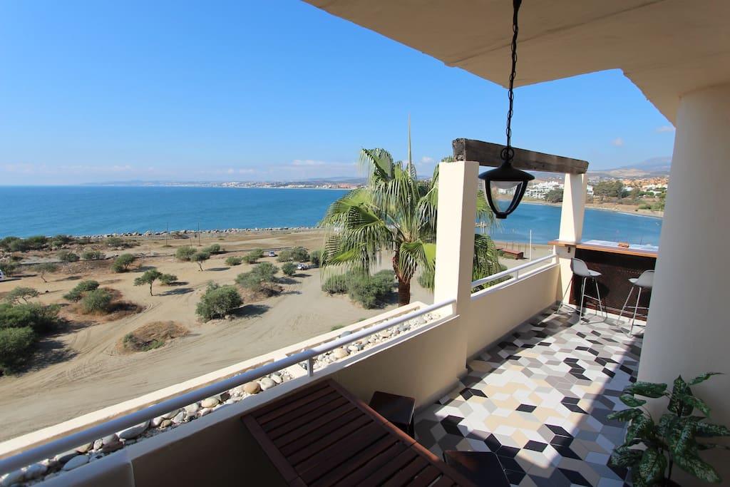 Spacious terrace with beach view bar