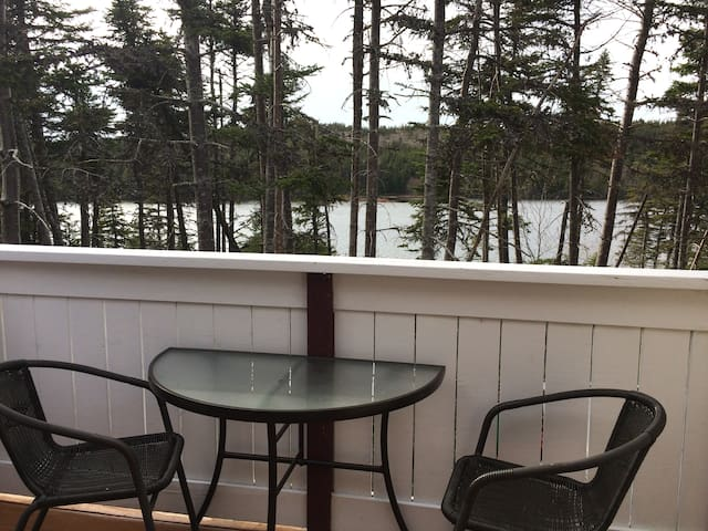 Private balcony overlooking Oxen Pond