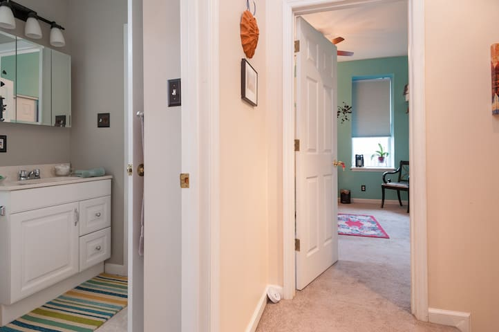 Bathroom access from suite or hallway.