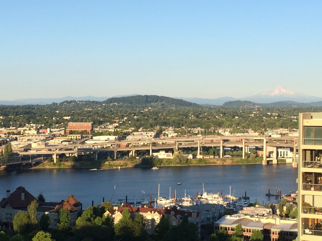 Large balcony with spectacular views of the Willamette River, Downtown Portland and Mt Hood
