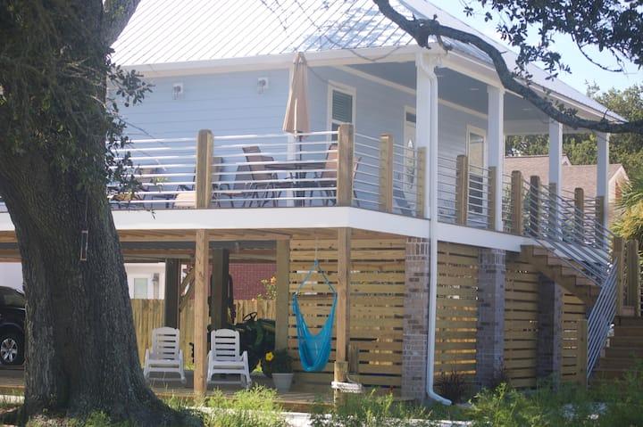 BRAND NEW Beach House. Steps to the beach.