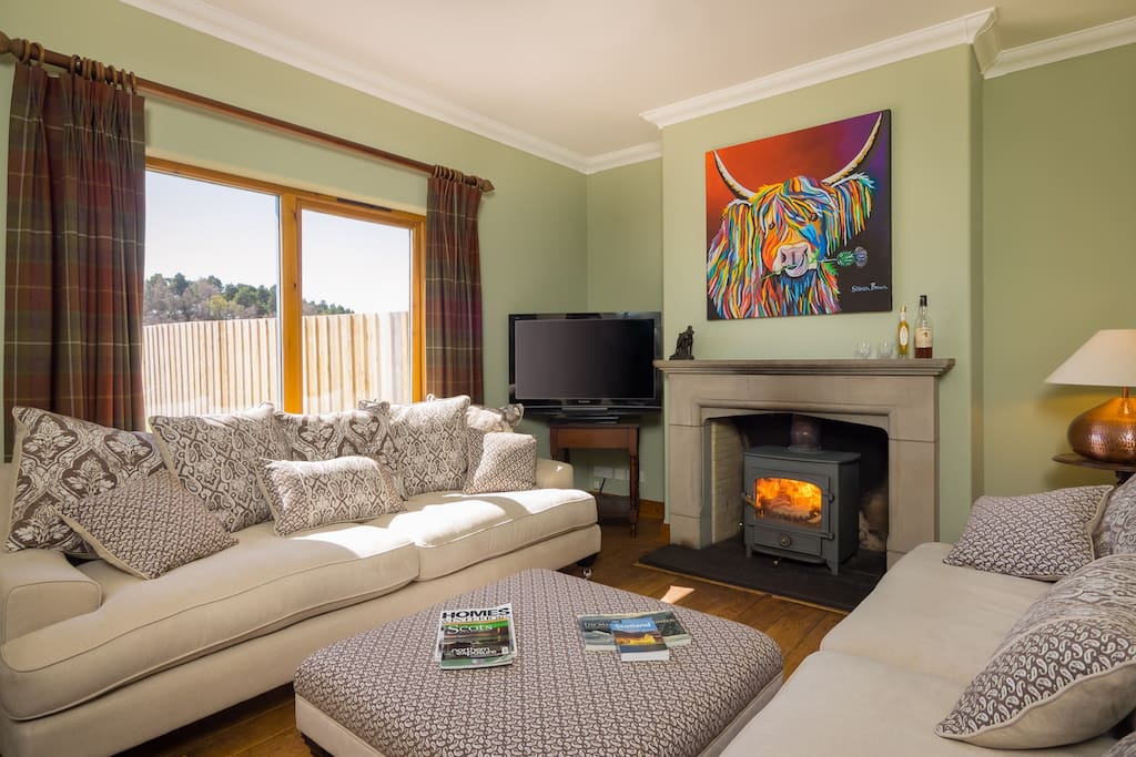 The cosy lounge with woodburner and extremely comfy sofas.