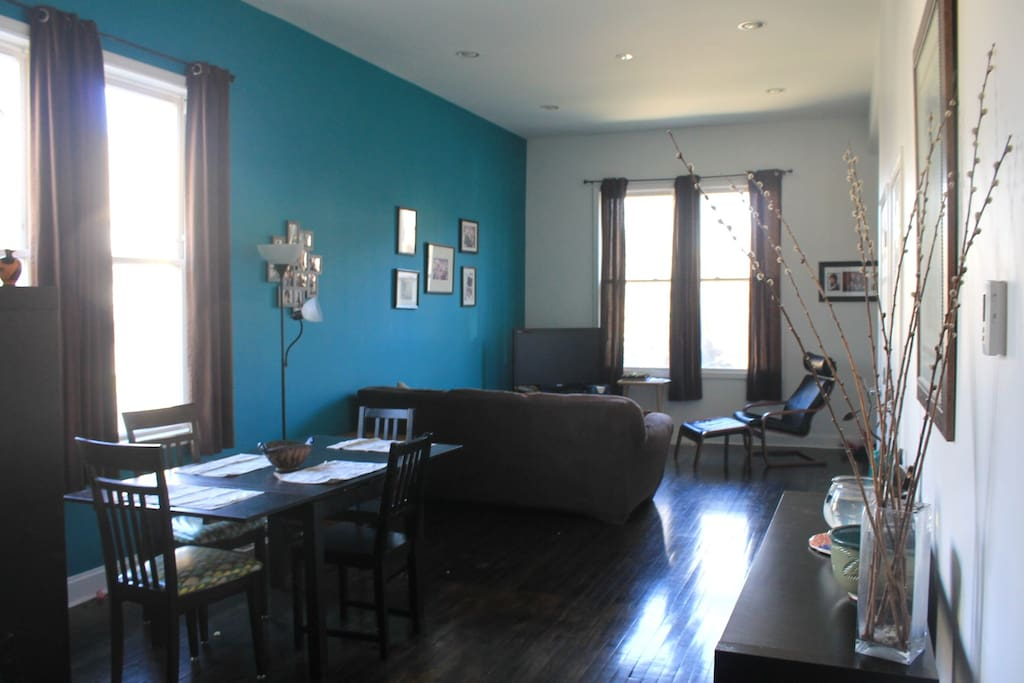 Our sunlit open concept dining room and living room.