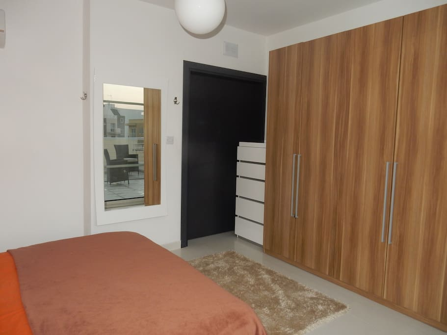 Main bedroom, large wardrobe, chest of drawers and large mirror