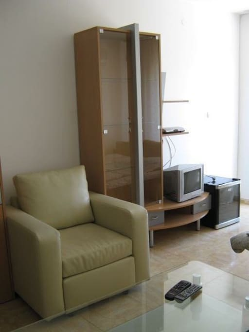 The living room with the TV (cable tv)