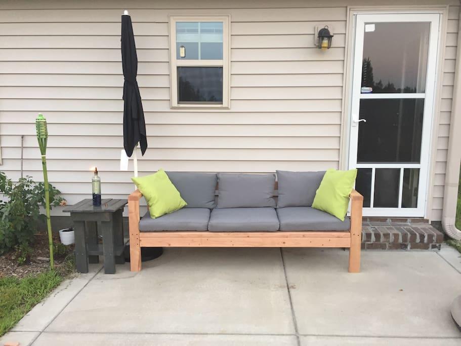 Hand made outdoor sofa. Come enjoy the backyard!