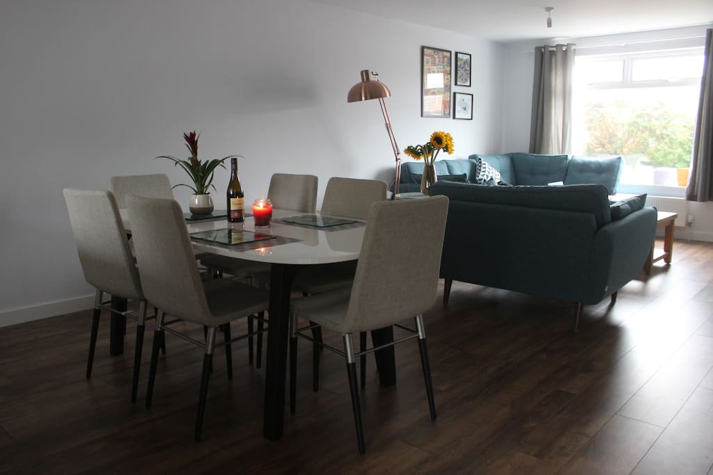 Dining table with sitting area behind