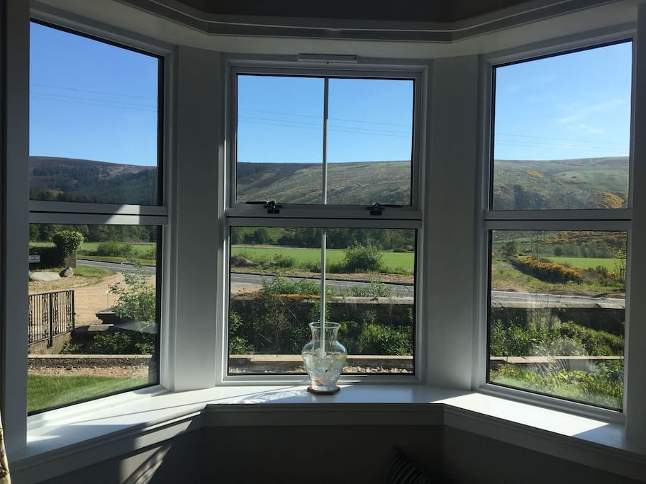 View from the from bay window to the hills on the other side of the Glen of Rothes.