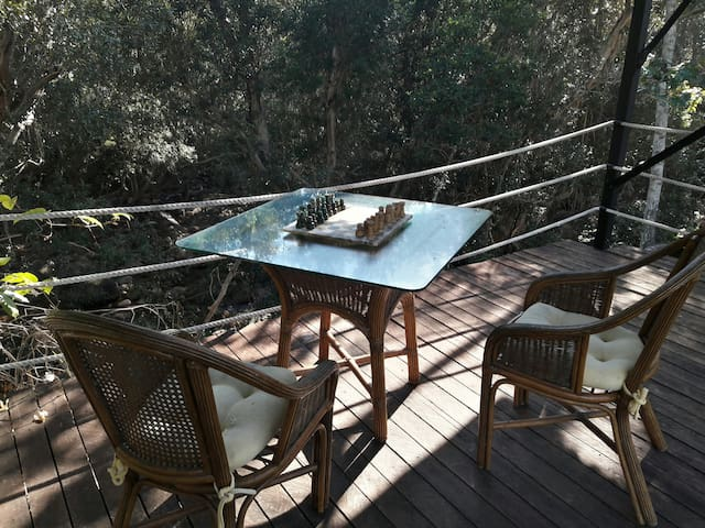 Right next to a Creek with covered sitting areas to relax and enjoy nature.
