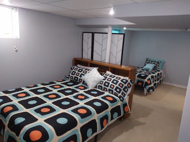 Basement bedroom with a queen bed and full bed