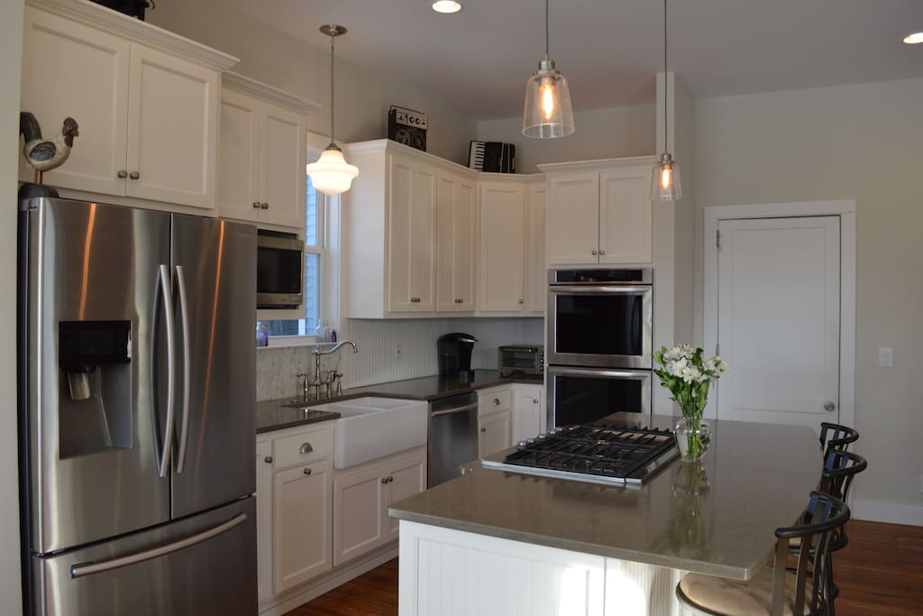 Brand new renovated kitchen with stainless steel appliances and eat in bar/kitchen
