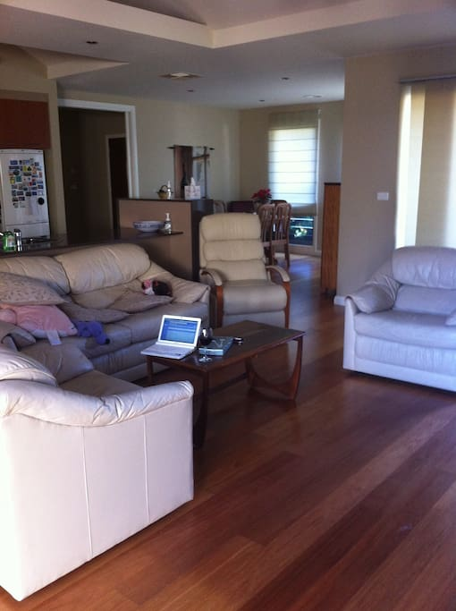 family room off kitchen and dining. leather chairs. stylish gas fireplace