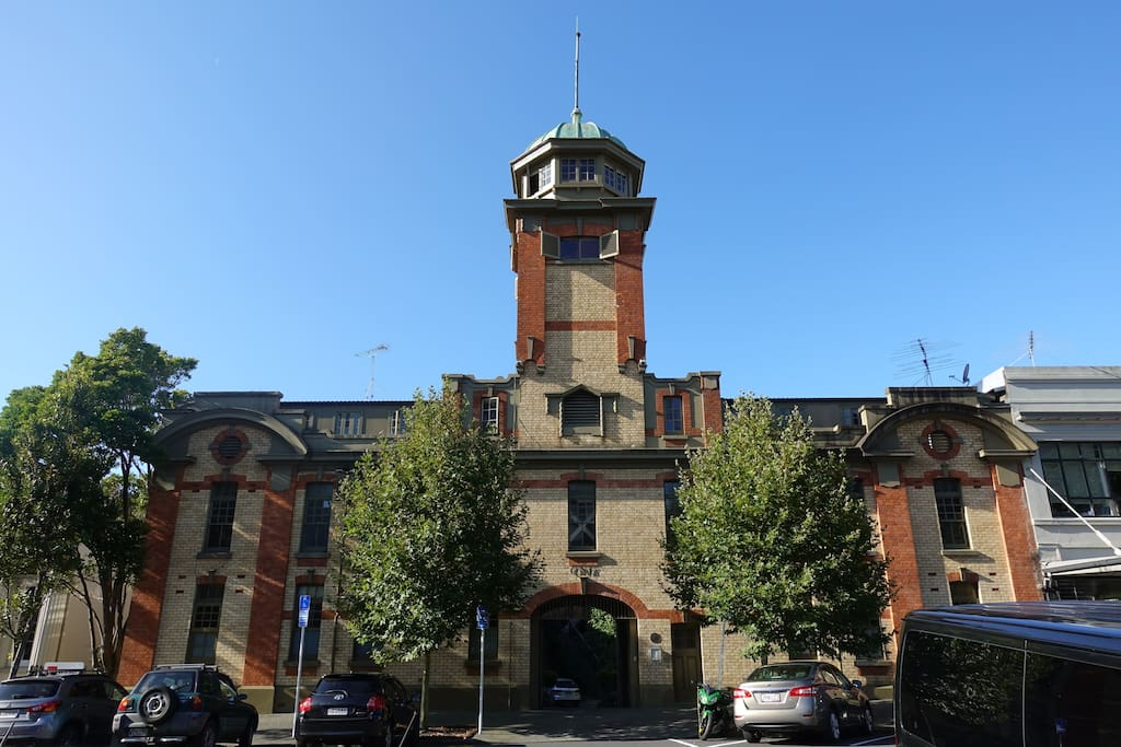 The Fire Tower on top of Auckland City Historic Fire Station - Now an incredible unique Airbnb! The apartment climbs up the tower with each room on a different floor and a 360 degree view and lounge at the top