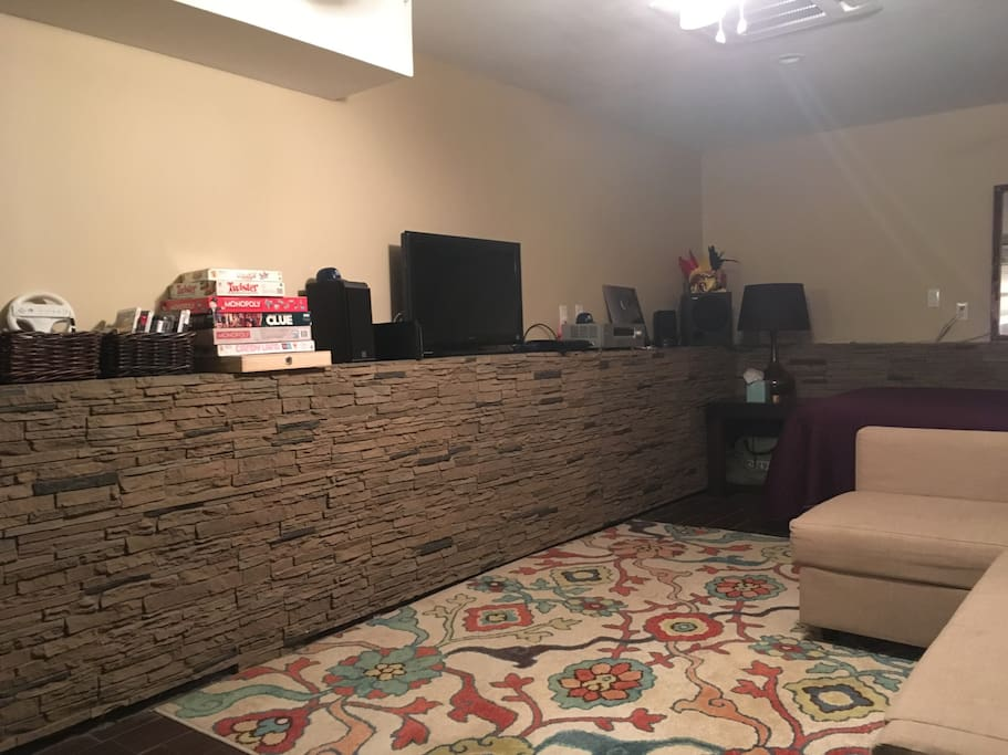 Sleep/Entertainment Area w/Surround Sound, Game Consoles, Board Games, Queen Bed, & Sleeper Sofa