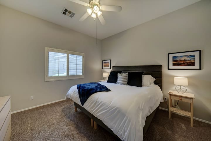 """Master bedroom has a king size bed, 6 drawer dresser, two nightstands, a walk in closet, attached bathroom and a 32"""" Smart TV."""