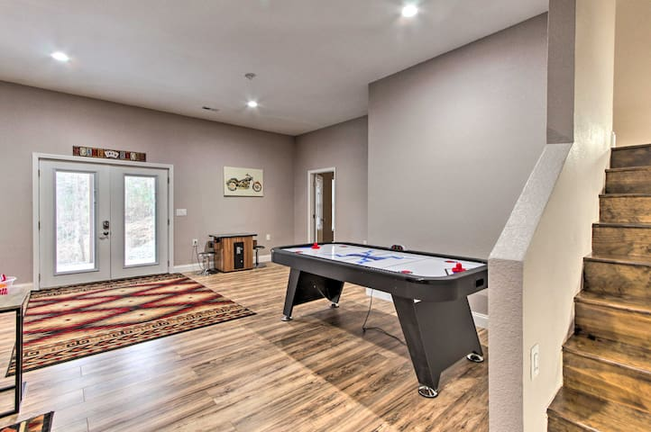 The vacation rental home features an air hockey table and arcade games!