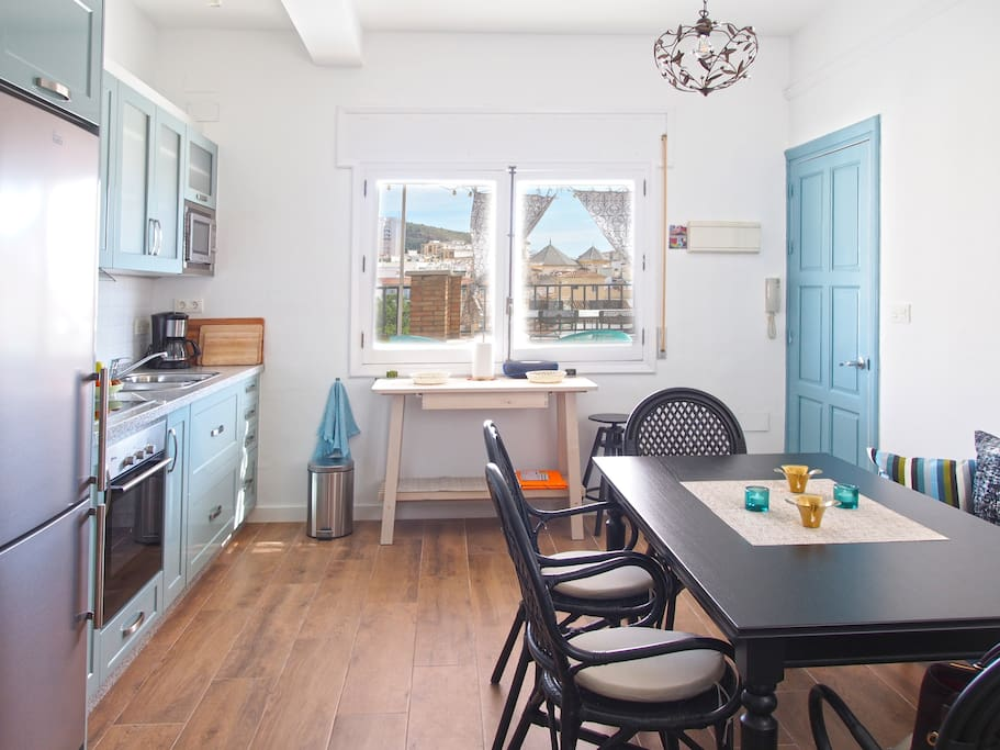 Kitchen with dining area. Door on the right leads to entrance hall and terrace