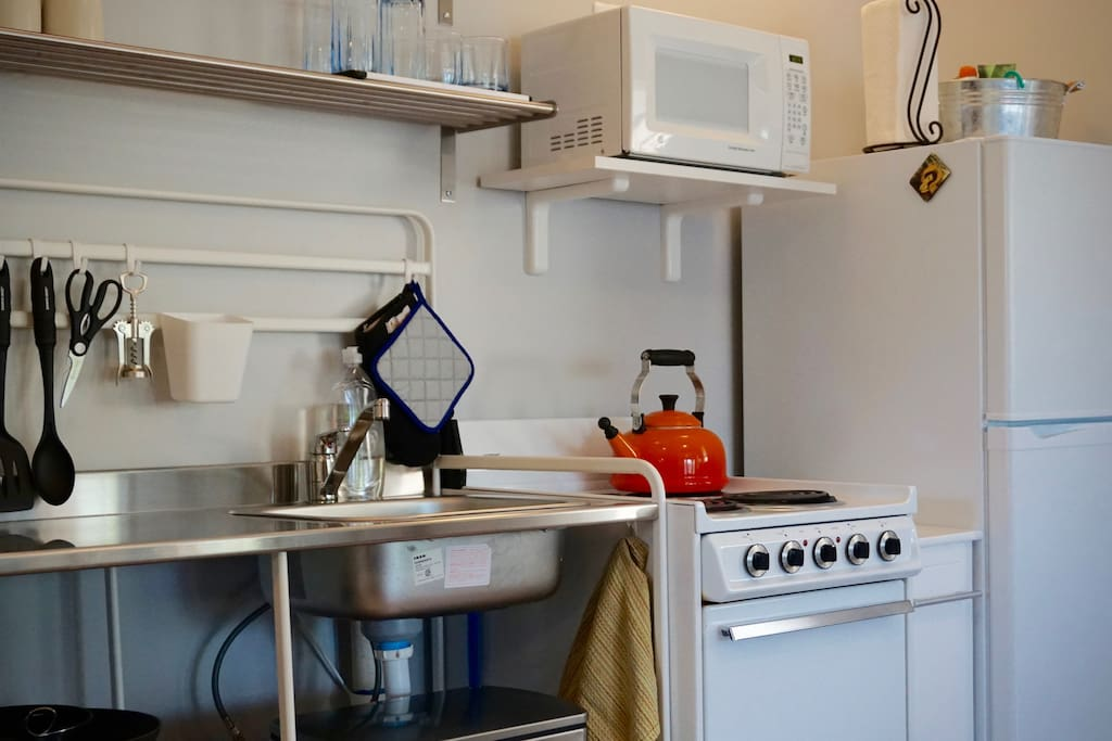 IKEA inspired kitchen for cooking or reheating simple meals. Coffee maker/tea kettle, microwave, toaster and some dishes provided.