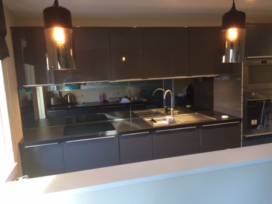A fully fitted kitchen, with fridge, freezer, dishwasher, Nespresso, washer dryer, oven and microwave.