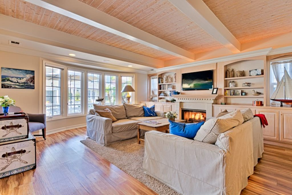 Cheerful, beautifully appointed Living Room begging you to relax and enjoy the fireplace and flat screen TV.