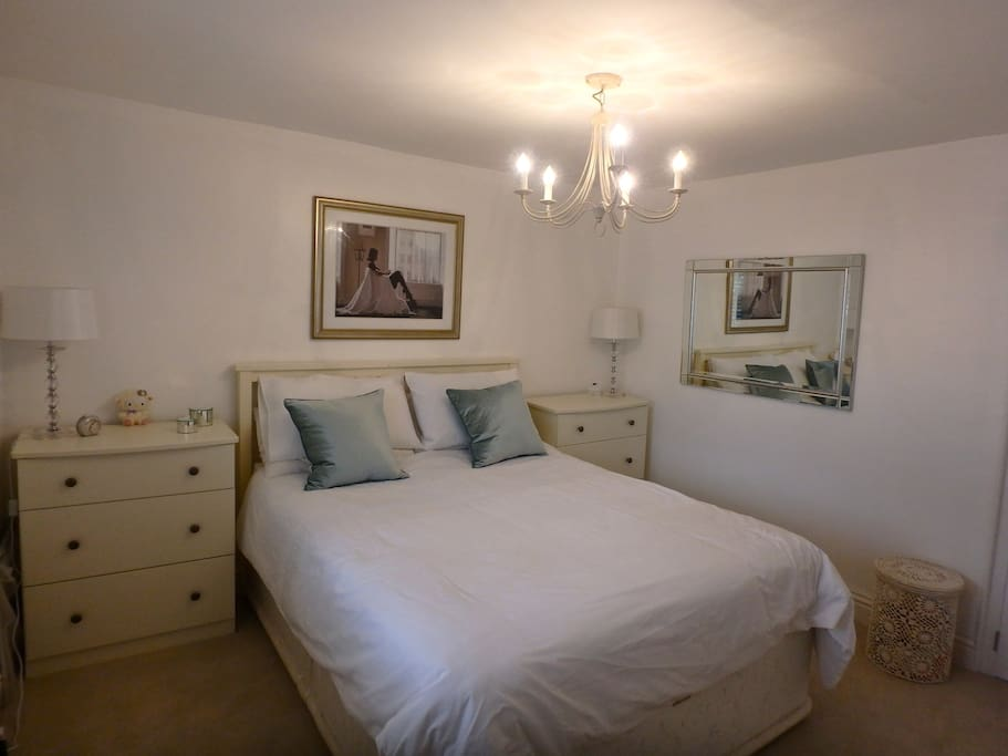 Master bedroom with wall mounted TV, high quality King size bed and luxury bed lining plus lots of wardrobe space