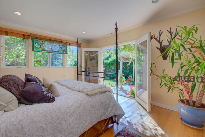 Enjoy the luxurious, spacious and private bedrooms. After rising to a sun-streaming stained-glass window circa 1920s, walk out the vine-covered suite to elegant old-growth gardens, grill and fire pit.