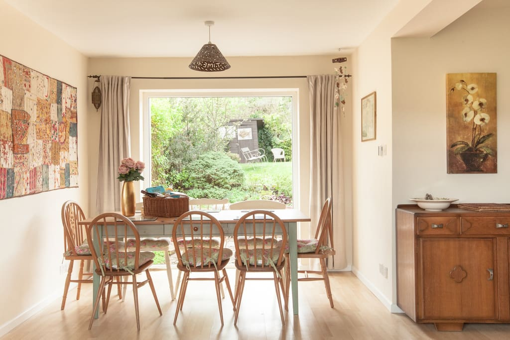 light filled dining area seats 8 with views to the back and front gardens at The Pink House Lulworth