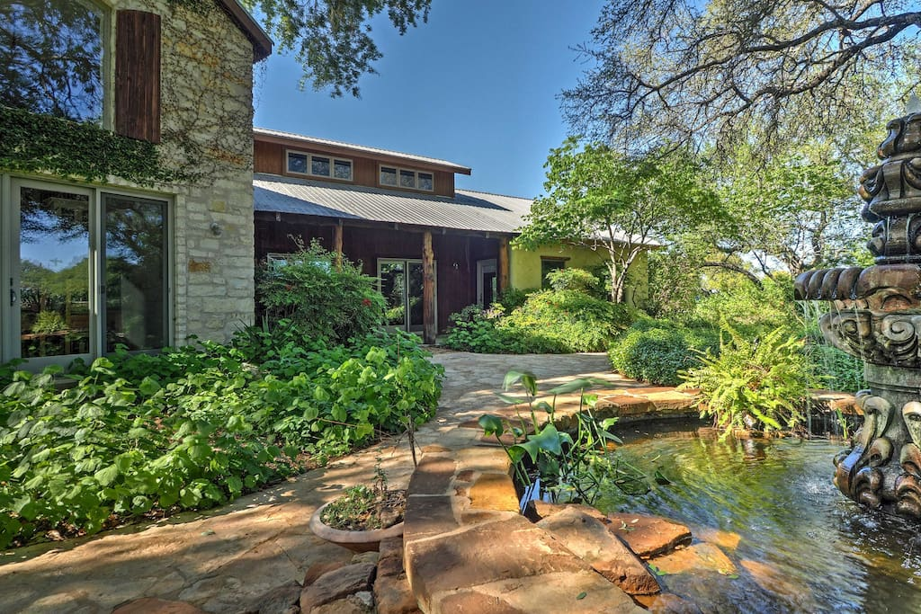 The lush foliage provides an idyllic backyard oasis.