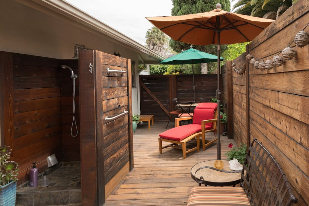 Second private patio great for evening relaxation. Outdoor beach shower and umbrella shade for outdoor dining.