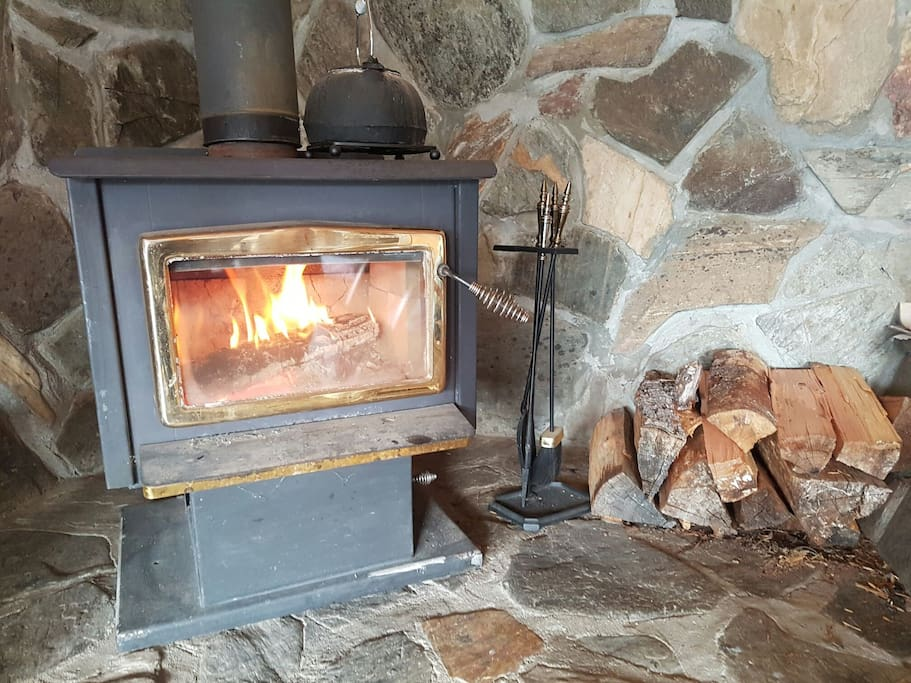 WETT certified wood stove. Fire and CO alarm provided.