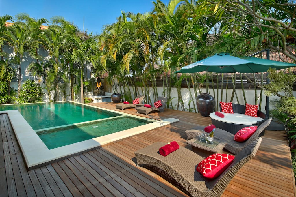 Exquisite L-shaped Pool with large wooden deck