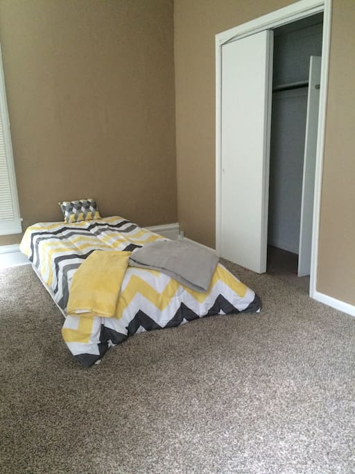 Twin bed, also has nightstand with tv and cable