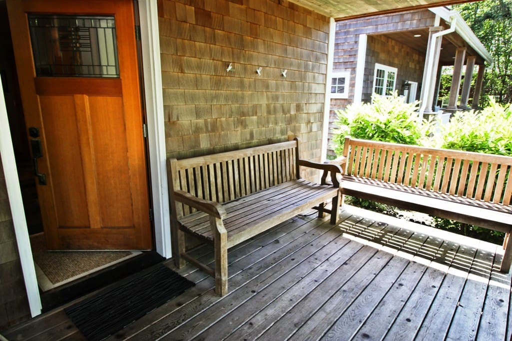 Covered front porch with benches.