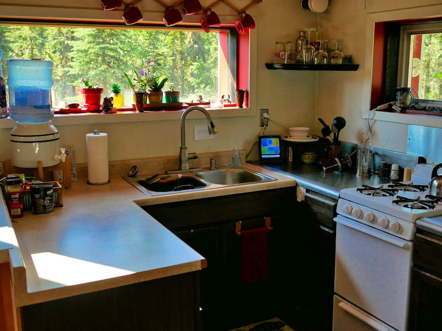 Make a simple meal or a gourmet course in this fully functional kitchen with running water, a propane stove top/oven, a small refrigerator, and basic amenities