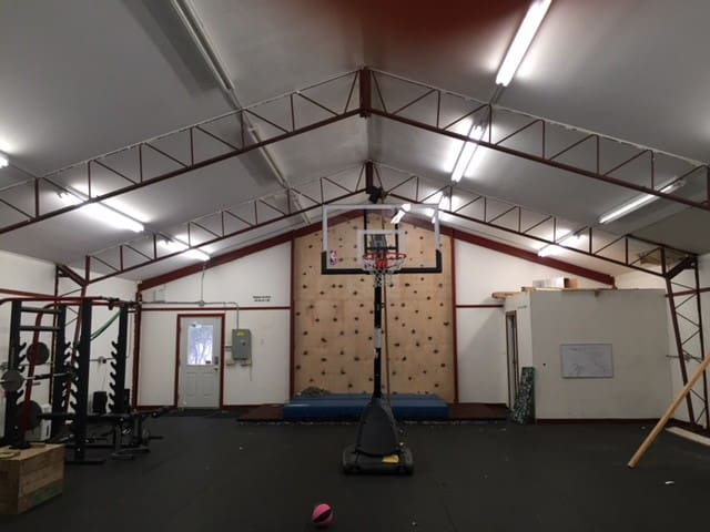 Huge separate outbuilding for the fitness enthusiast.  Basketball, full weight set, Arc machine, box jumps, climbing wall and climbing rope. Heated in winter.