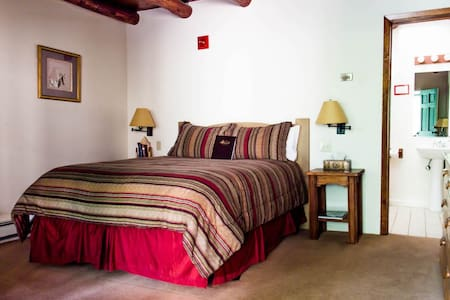 We have 3 queen size bed rooms on our property, all upstairs, not dog-friendly.  See our other listings on AirBnB for larger rooms (king size and family suites) that are also pet-friendly.