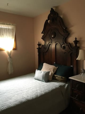 Hand crafted bed frame, comfortable custom fitted mattress. Matching vanity with ample dresser space.