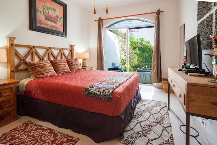 - Guest bedroom 2 with queen bed and private pool view terrace