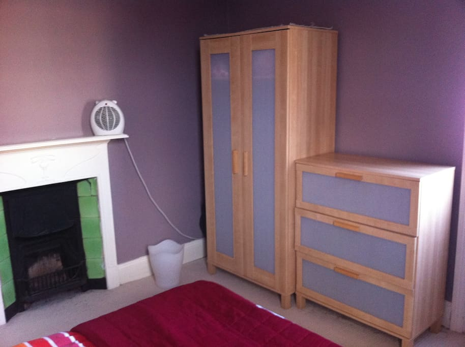 Drawers and wardrobe (open fire doesn't work but there is a radiator and electric heater in the room).