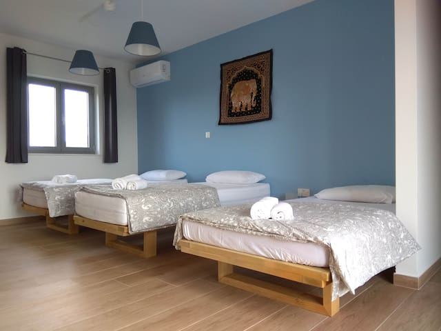 Bedroom for 3 guests. Either 3 single beds or 1 single and a double bed.