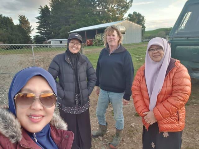 "Guests grab a quick ""selfie"" with host Suzie after a farm tour."
