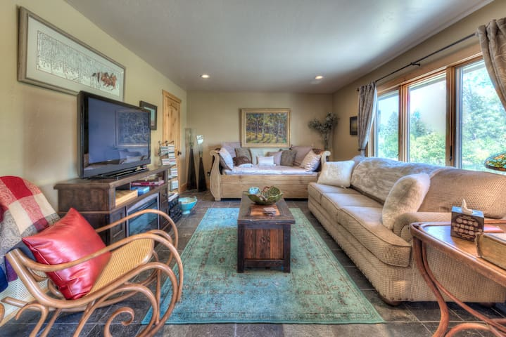The 2nd bedroom has a trundle bed with 2 single beds, and a 7 ft long comfortable couch. There is a closet, a large screen t.v. with a wonderful sound system with speakers in great room & back deck. The electric fireplace can warm you up in a jiffy!