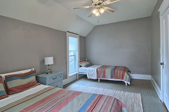 This is the second bedroom upstairs.  There is a queen and a twin bed, a large closet, and a small chest of drawers.