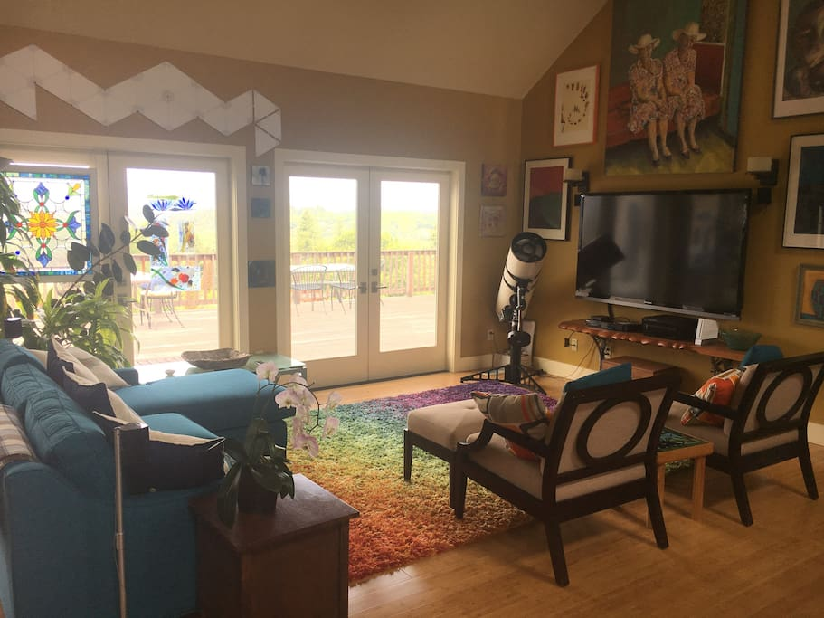 Large private guest's Living Room with doors out to the huge Deck