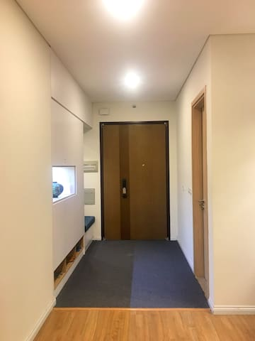 Entrance to the apartment. A big cupboard with a mirror is used to stock slippers, extra toilet papers, extra towels