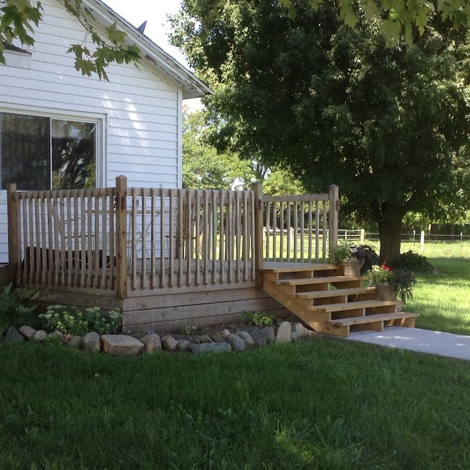 Deck for outside eating or watching the cattle or horses.
